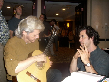 Brian conferring with luthier Jean Rompré at a convention in Montreal.